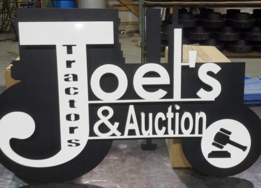 Custom dual level sign created from business card logo